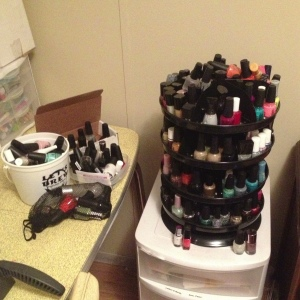 Here is what my nail polish used to look like. Rotating nail polish tower full, polishes spilling out into buckets and bags and boxes.