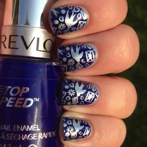 Here is the finished product! Revlon Royal is the base with Blue Rhapsody stamped over the top using Cheeky plate CH 52.