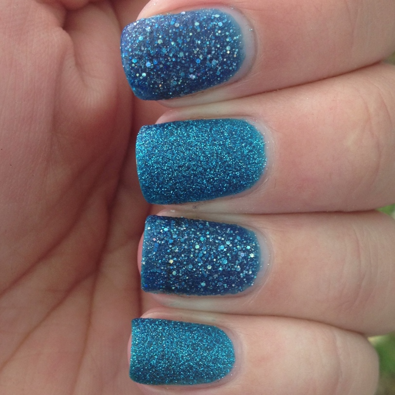 OPI on my index and ring fingers, Zoya on my middle and pinkie. Indirect light.